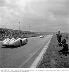 The two Mercedes W196 streamliners driven by Juan Manuel Fangio and Karl Kling accelerating down the main straight from Thillois toward the start/finish line during the French Grand Prix at Reims, 4th July 1954. (Photo by Klemantaski Collection/Getty Images)