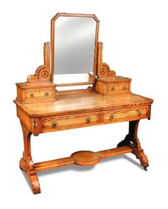 Sale D101215 Lot 678  A Gothic Revival painted pine dressing table in the manner of Charles Bevan, with mirror and drawer superstructure, the table with two short frieze drawers raised on a carved sleigh base h:152 w:122 d:60 cm  - Cheffins