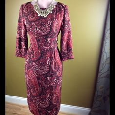 Dark Red Paisley Pencil Dress Dark red/Maroon pencil dress in a pretty paisley print. Belt ties in the back. Fully lined. Perfect condition.Bust: 17 inches Length: 39 inches Sleeves: 17 inches Material: 100% Polyester ❌NO TRADES❌ Talbots Dresses Midi