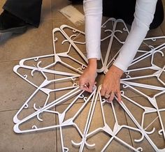 With 16 hangers woman makes beautiful snowflake decoration Woman Takes 16 Hangers And Makes Beautiful Snowflake Decoration Diy Christmas Decorations, Snowflake Decorations, Diy Christmas Ornaments, Homemade Christmas, Christmas Projects, Holiday Crafts, Christmas Holidays, Christmas Tables, Nordic Christmas