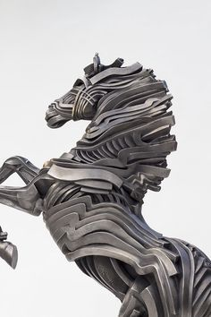 Gil Buvel #Sculpture | ... Figure Sculptures Composed of Unraveling Steel Ribbons by Gil Bruvel