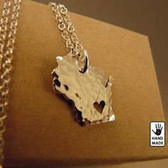 """Wisconsin State, FS .999 (pure silver) pendant necklace, 20"""" length, hammered finished for $35 + shipping Link for the smooth (not hammered) version: https://www.etsy.com/listing/121905477/wisconsin-state-solid-sterling-silver?ref=shop_home_active"""