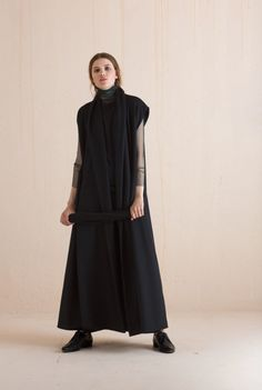 Osa, long wool coat in black is available on Cortana´s eshop Ready-to-Wear Collection!
