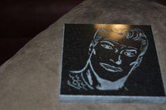 Classic Aquaman on black granite tile.