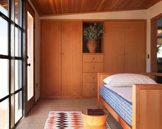 Alison and Jay Carroll transformed a boarded-up homestead into their own modern oasis Bedroom Ceiling, Bedroom Wall, Bedroom Decor, Decor Room, Boarding Up Windows, Wood Daybed, Local Contractors, Desert Homes, Wood Ceilings