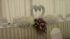 Bespoke swans made for a Ballerinas wedding by The Flower Academy Inc Ltd. www.thefloweracademy.org