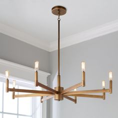 Sleekly Modern Squared Chandelier – 8 Light Less is more with this sleek minimalist chandelier. The thin bar arms and simple cylindrical candle sleeves are perfect for adding modern pizzazz to understated decor. Kitchen Chandelier, Chandelier In Living Room, Rustic Chandelier, Chandelier Lighting, Chandelier Shades, Stairwell Chandelier, Simple Chandelier, Round Chandelier, Chandelier Ideas