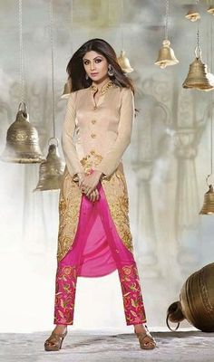 Stun the crowds like Shilpa Shetty in this pale pink crepe silk and velvet asymmetrical straight pant suit flaunts crystals and resham embroidered floral motifs on the central panel and flowy patterns adorning the lower asymmetrical hemline part intensifies the suit look. #BollywoodDresses