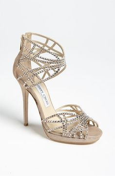 Jimmy Choo 'Diva' Sandal - Scintillating architecture and precision-set crystals create captivating after-dark sparkle on a cut-out, champagne sandal.