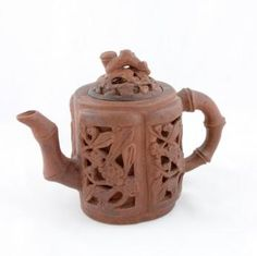 Yixing Teapot: Made from purple tinted clay that is found just outside the town of Yixing, about 100 miles from Shanghai. The first Yixing clay teapot by a monk from the Jin Sha temple, in the 1500s. Yixing teapots were thought to bring out the best flavor of the Chinese teas. The pots were made for individual use and the owners would drink their tea directly from the spout. Owners of the Yixing teapots generally steep only one type of tea in the pot. This is due to the pots being unglazed.