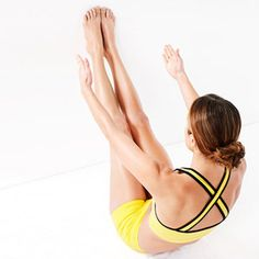 Extend legs up, keeping feet against wall, then press rounded lower back into floor and squeeze abs as you lift arms to reach toward feet, elbows soft. Make it harder: Press feet into wall as you reach.  Do 20 pulses: Curl torso up 1 inch, then lower 1 inch.  Do 3 sets, hugging knees to chest to rest between sets.