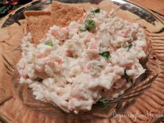 Hot Crab Dip~ Ingredients 1/2 cup milk 1/3 cup salsa 3 packages (8 oz., each) lowfat cream cheese 2 packages (8 oz., each) imitation crabmeat, flaked 1 cup thinly sliced green onions 1 can (4 oz.) chopped green chilies Assorted crackers