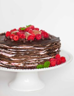 Layers upon layers of decadent chocolate crepes, dressed with raspberry mascarpone cream! This delicious chocolate cake is a chocolate lover's dream!