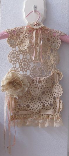 I would dye the lace a richer colour and add a gold silk flower, maybe a tassel