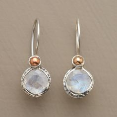 Dimpled sterling silver bezels bring moonstone's heavenly iridescence down to earth. A copper bead tops each faceted gem. French wires. Exclusive.
