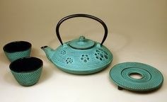 A beautifully textured blue cast iron #teapot with 2 matching cast iron teacups and teapot stand.