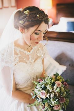 Braided up do with fresh flowers  | Photography by http://www.sallytphotography.com/