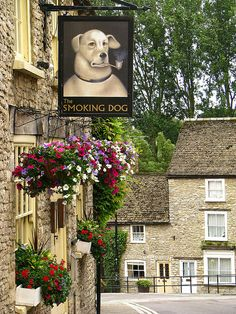 Smoking Dog Pub in Malmesbury UK~ Malmesbury is an early hilltop town on the edge of the Cotswolds, England and is worth a visit. Take tea at the ancient Bell Inn - lovely.