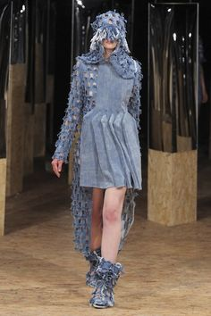 arms and legs are attached to your head to signify being controlled by your mind and what you think.   face covered - shyness, scaredness, eyes covered from what you know, confusion, lost    Lucy Adjoa Armah LCF F/W 2012