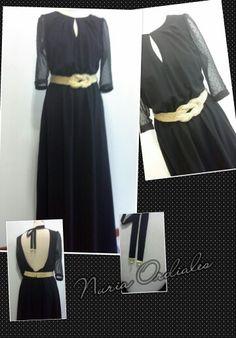 Vestido largo  de gasa negro con mangas de plumeti y escote en espalda. Cinturon de nudo marinero en dorado