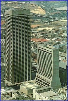 South Africa's first skyscraper, The Carlton Centre in Johannesburg at 50 stories high. The Carlton Hotel is alongside. Very hip place to hang out in its day! Johannesburg City, Carlton Hotel, Out Of Africa, Famous Places, African History, Africa Travel, Architecture, Live, South Africa