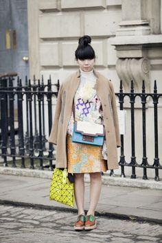 """Issey Miyake """"Bao Bao"""" tote bag in yellow neon plastic chic urban street style"""