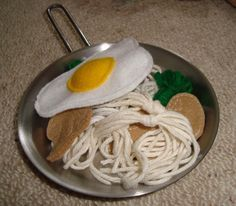 play noodles made using cream and white knitting yarn tied together in the middle!