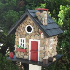 Charming Country Bungalow Birdhouse - our feathered friends would real live in style in this cute birdhouse.