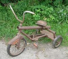 Antique Metal Chain Driven Rear Wheels Tricycle Trike AMF Junior Rocket.  Peter had a similar elongated bike (dark red and white).  He took Nancy rides on it.
