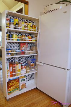 rollout cabinet for kitchen. Post suggests a floor stop (just a little 1x1 near the front of the fridge) to keep the cabinet from pulling all the way out