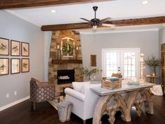 Fixer Upper host Johanna Gaines warmed up the once bare living room with a natural stone fireplace, exposed beams and architectural accent pieces, as shown on HGTV.com.