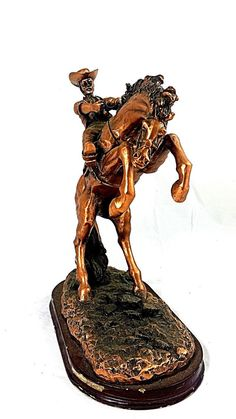 Up for sale is a Cowboy Riding Horse Statue Sculpture Bronze Covered Figurine 11 Cowboy W/ Horse. This Bronze Covered Statue is in good