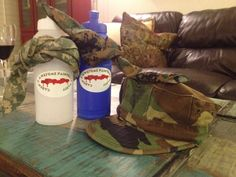 Paintball party favors. Water bottles, camo bandannas & hats from military surplus.