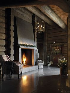 Log home with a sleek looking fireplace - nice combo