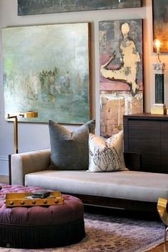 Living rooms with abstract art as the central piece