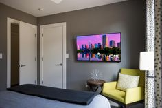 A home away from home, this cheerful bedroom with five-star amenities is sure to prompt an extended stay.