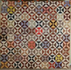 """This ELEGANT cotton 1870's (some fabrics are much earlier) """"old Italian block"""" quilt is hand pieced and hand quilted, with an eye catching overall lattice design. The quilt came out of Berks County, Pennsylvania."""