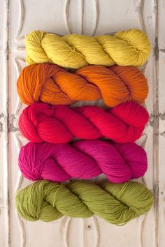 The Yarn for Garden House Baby Blanket kit includes 8 skeins of O-Wash Fingering - 1 skein each of Colors A & E, and two skeins each of Colors B, C & D. Each kit includes enough yarn to make either th Yarn Color Combinations, Colour Schemes, Knitting Yarn, Knitting Patterns, Knitting Projects, Yarn Inspiration, Yarn Thread, Yarn Colors, Hand Dyed Yarn