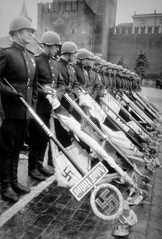 Defeat… Soviet soldiers standing together as they present the military banners of the defeated Nazis. Note the first soldier and the lack of the banner. That one belongs to the infamous 1st SS Division Liebstandarte Adolf Hitler. The banner was never found or captured; whereabouts are unknown or possibly it was destroyed during the battle for Berlin. There are some theories that it was saved and preserved by the post-war Nazi insurgency group/plan known as Werwolf; German for Werewolf.