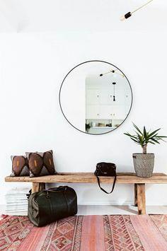entryway with circular mirror