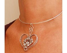 Necklace-Heart of braided silver plated wire with spirals inside