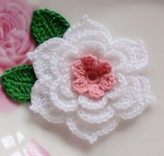 This crochet flower with leaves made with sheeny cotton yarn Flower layers): Flower color: dusty rose. Leaf size: L leaf color: green You can sew the crochet flower on to dress, bag, hair clip, brooch, etc Thanks for looking! Beau Crochet, Crochet Puff Flower, Crochet Flower Tutorial, Knitted Flowers, Crochet Flower Patterns, Irish Crochet, Free Crochet, Knit Crochet, Cotton Crochet