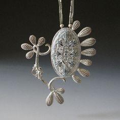 "Tamara Grüner -   Necklace ""Esbeco"" 2011  Historical metal pressing, plastic, silver, paint, glass;  11,3 x 9,6 x 0,9 cm"