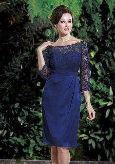 Fitted sheath style dress with gathered bodice, asymmetrical neckline and draped back.