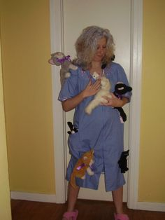 crazy cat lady costume -- use bathrobe and pin stuffed animal cats to it...