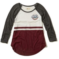 Hollister Notch Front Raglan Graphic Tee (€17) ❤ liked on Polyvore featuring tops, t-shirts, burgundy and white, white graphic t shirt, scoop neck tee, scoop-neck tees, raglan tee and color block tee