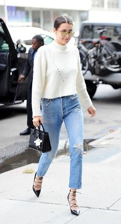 Bella Hadid makes a turtleneck youthful by wearing it with jeans and lace-up heels.