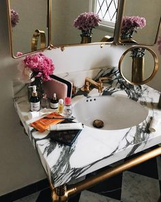 Love the marble sink look