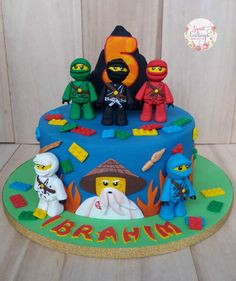 The birthday boy is a super fan of Ninjago and requested for all 5 figurines and the master to be included. This cake was inspired by a similar piece from Cuteology Cakes. Ninja Lego Cake, Ninja Birthday Cake, Lego Ninjago Cake, Birthday Cake Kids Boys, 6th Birthday Cakes, Ninjago Party, Lego Birthday Party, Bolo Lego, Themed Cakes