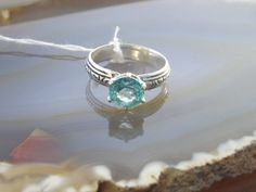Teal Topaz Solitare by ArcticFireDesigns on Etsy